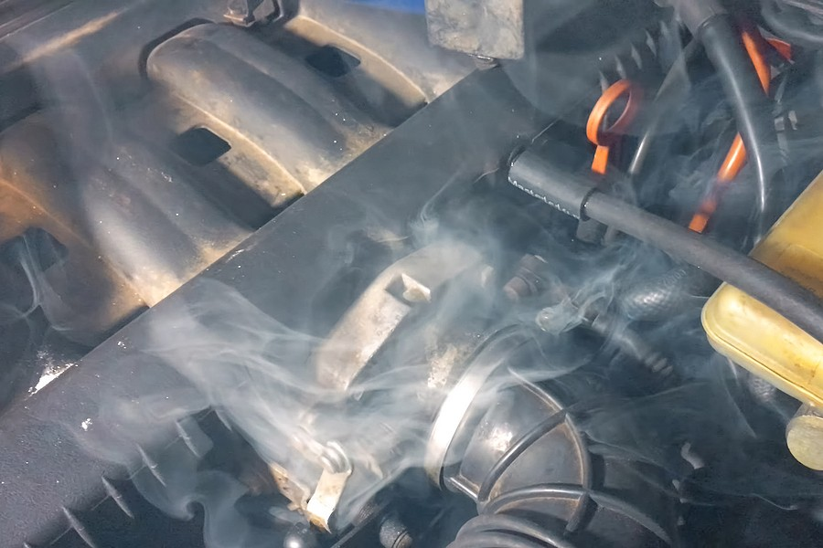 Car Smoking from Under the Hood? Here's What to Do
